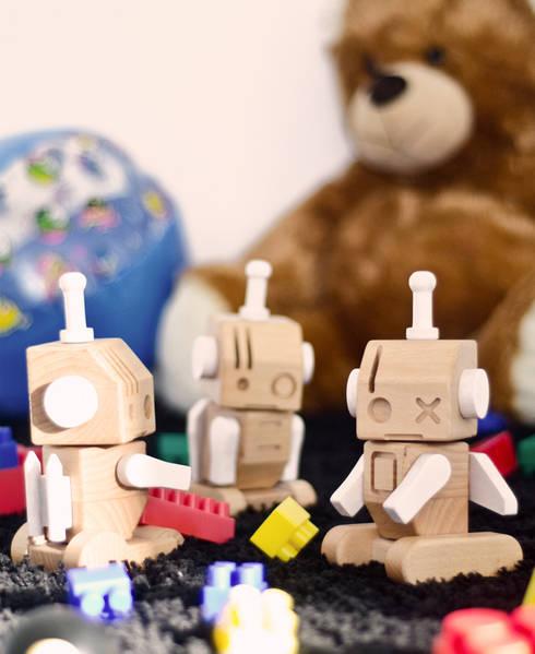W-Robots: Stanza dei bambini in stile  di Luca Binaglia Design