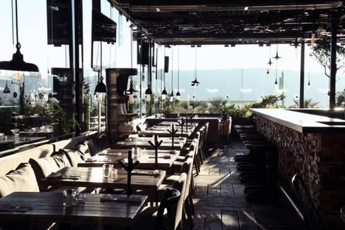 Restaurant Sonora Grill Juriquilla: Comedores de estilo ecléctico por PASQUINEL Studio