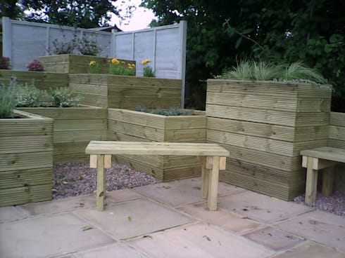 planters with a seat:  Garden  by SD GARDEN DESIGNS