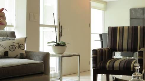 PALMAS 10: Salas de estilo moderno por NIVEL TRES ARQUITECTURA