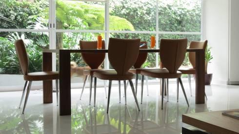 PALMAS 07: Comedores de estilo moderno por NIVEL TRES ARQUITECTURA