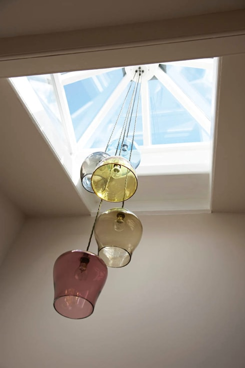 Bespoke glass chandelier suspended from a central skylight: eclectic Corridor, hallway & stairs by Concept Interior Design & Decoration Ltd