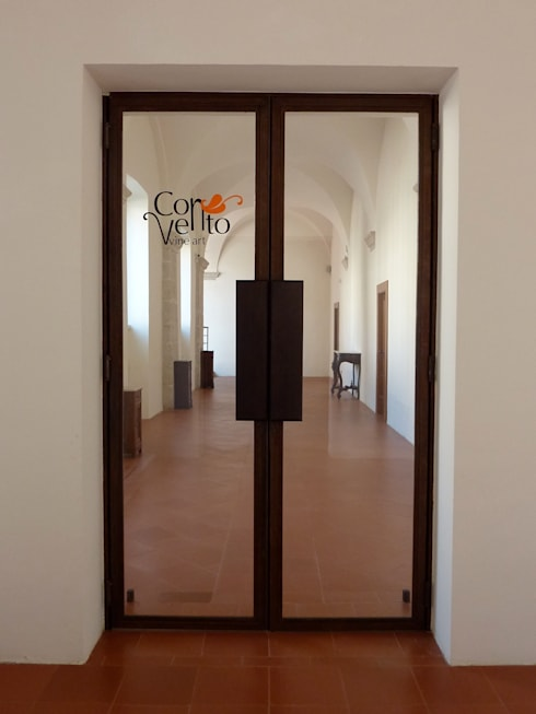 CORTEN : Finestre & Porte in stile in stile Eclettico di ARTEMATICA studio