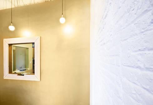 TIENDA ORO: Oficinas y Tiendas de estilo  de Piedra Papel Tijera Interiorismo