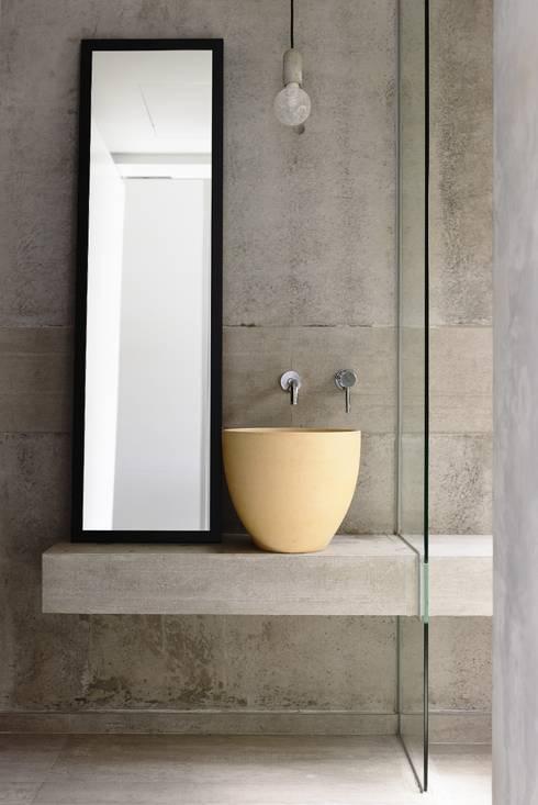 Well of Light: modern Bathroom by HYLA Architects