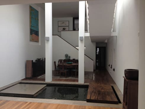 Living room / dining room: eclectic Living room by elliot James Pte Ltd