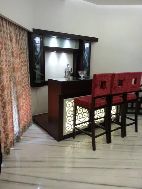 Mini bar: modern Living room by KathKarma Interior Designer & Space Planners