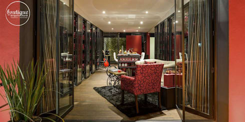 Estudio Coyoacan: Salas de estilo moderno por Boutique de Arquitectura  (Sonotectura + Refaccionaria)