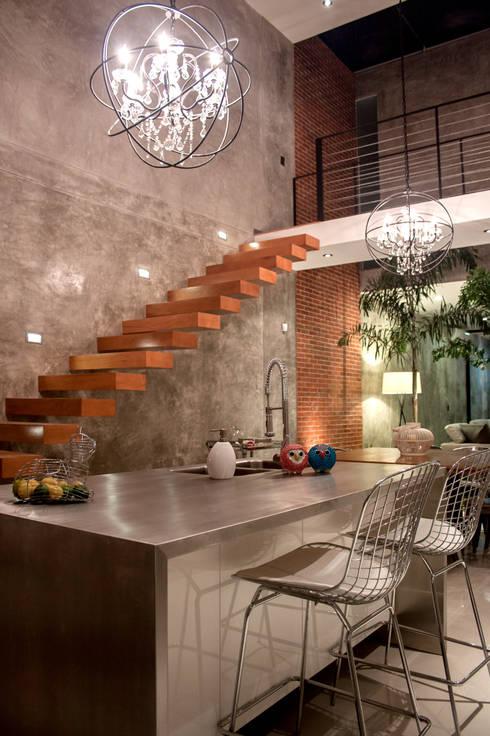 Casa in stile  di Desnivel Arquitectos