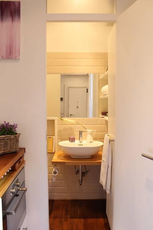 Casas de banho  por Arch. Silvana Citterio