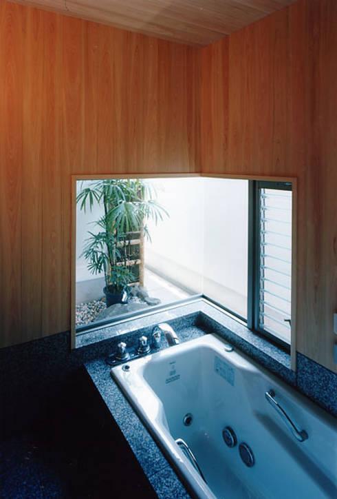 タイトルを入れてください: MOW Architect & Associatesが手掛けた浴室です。