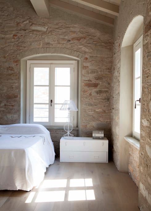 rustic Bedroom by Architetto Silvia Giacobazzi