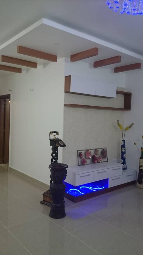 T.V unit : modern Living room by Arka Interio