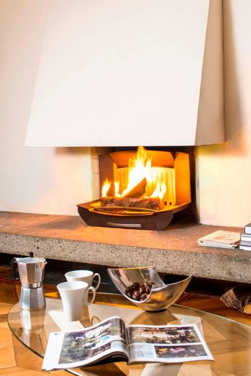 l 39 insert ouvert dans une chemin e classique par finoptim homify. Black Bedroom Furniture Sets. Home Design Ideas