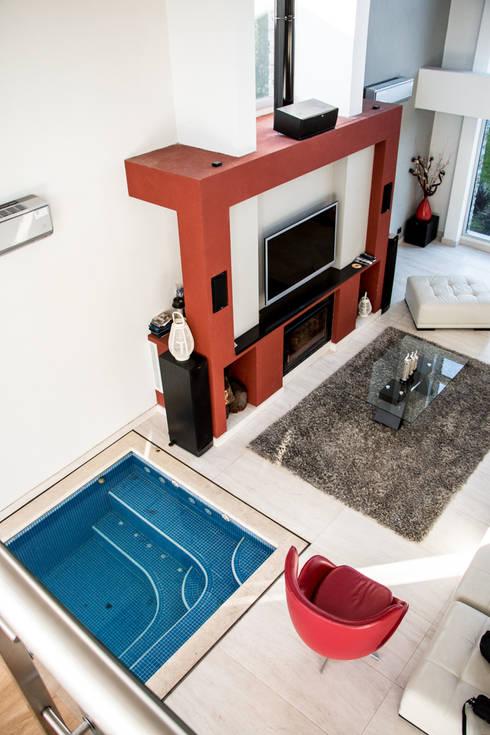 Metamorfosis arquitectònica: viejo espacio/nuevo uso: Livings de estilo moderno por LEBEL