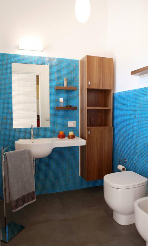 Consigli per l 39 arredamento di un piccolo bagno - Piastrelle bagno altezza giusta ...