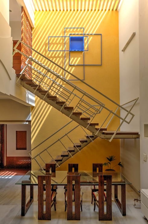Staircase + Dining: modern Houses by Studio An-V-Thot Architects Pvt. Ltd.