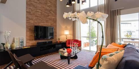 Jardim Paulista | Residenciais: Salas de estar modernas por SESSO & DALANEZI