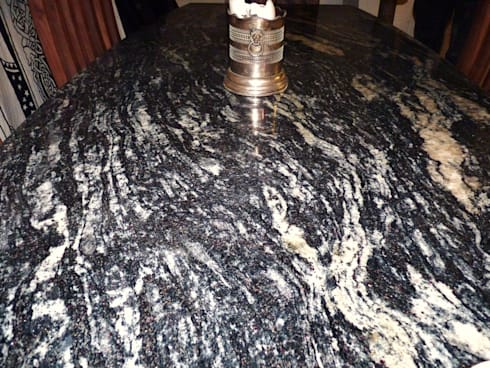 Cosmic Black Dining Table:  Dining room by Stone Smart