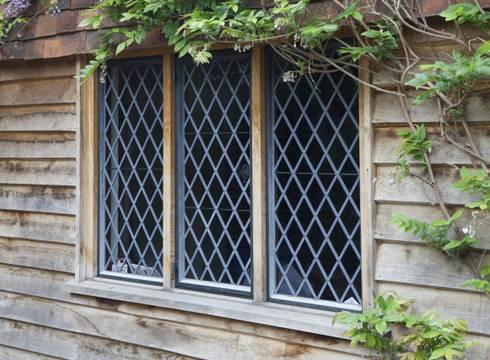 Traditional Diamond Leaded Heritage Bronze Casements:  Windows & doors  by Architectural Bronze Ltd