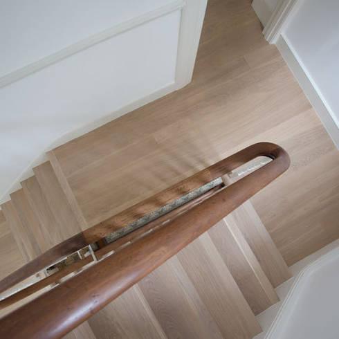 Contemporary stairs with oak flooring: modern Corridor, hallway & stairs by Fine Oak Flooring Ltd.