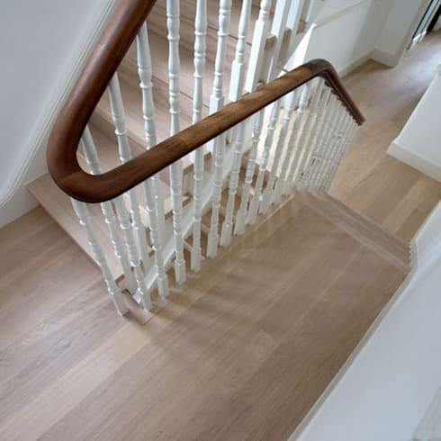 Newly fitted flooring and stairs: modern Corridor, hallway & stairs by Fine Oak Flooring Ltd.