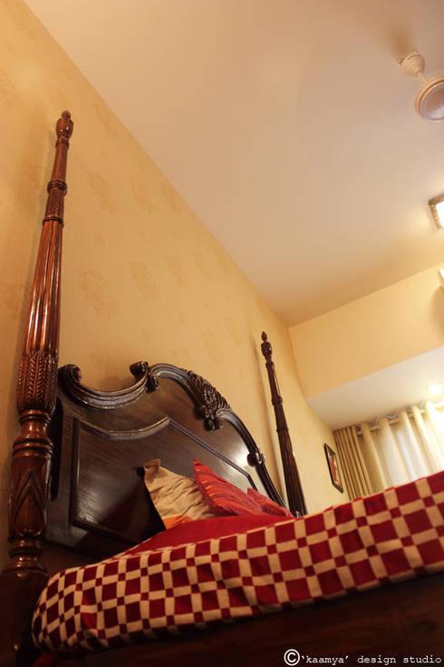 Master bedroom_4 post bed:   by kaamya design studio