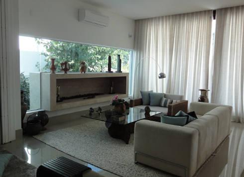 Casa Canto da Lagoa AF: Casa  por Klenner & Michel Arquitetos Associados