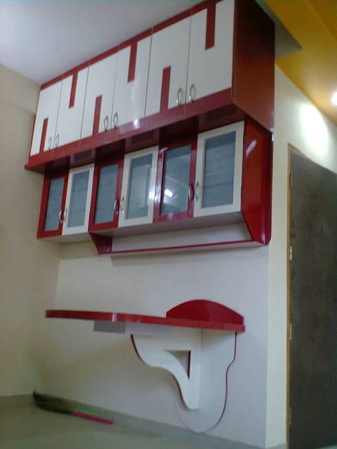 Cozinhas modernas por ajinkyainteriors