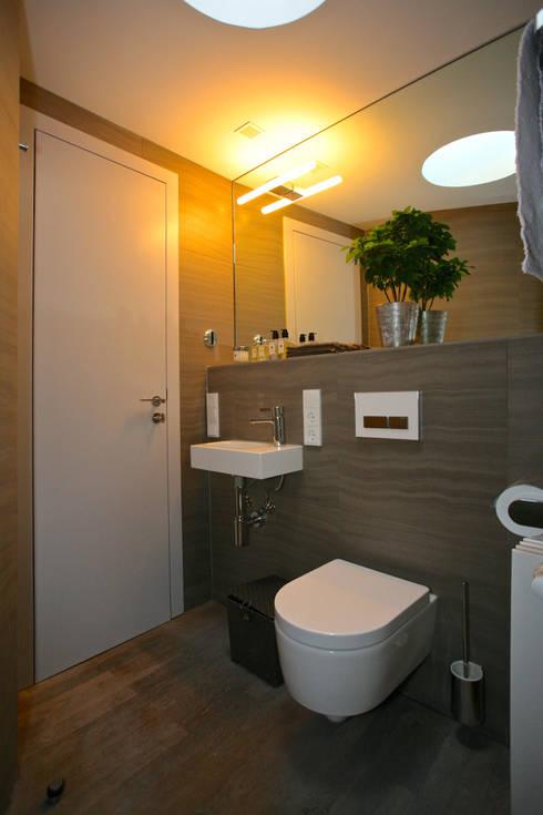 Gästebad:  Badezimmer von tredup Design.Interiors