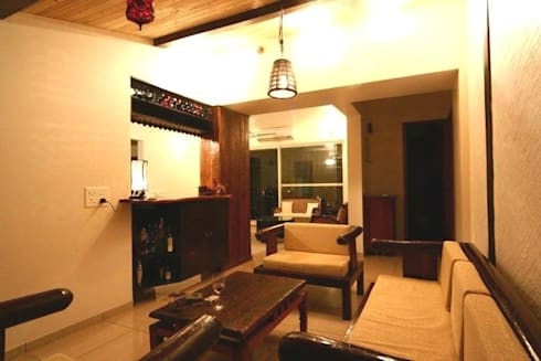 Interior projects: rustic Houses by Uttara And Adwait Furniture