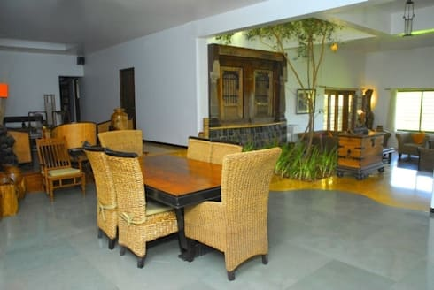 Kher Residence: rustic Houses by Uttara And Adwait Furniture