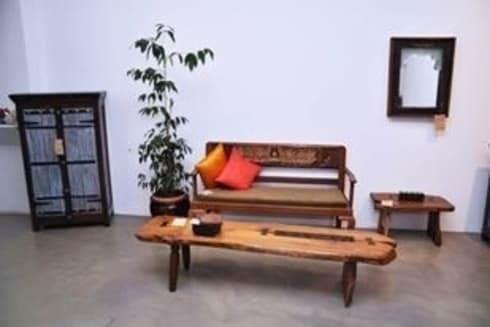 Sofas and seating :  Living room by Uttara And Adwait Furniture