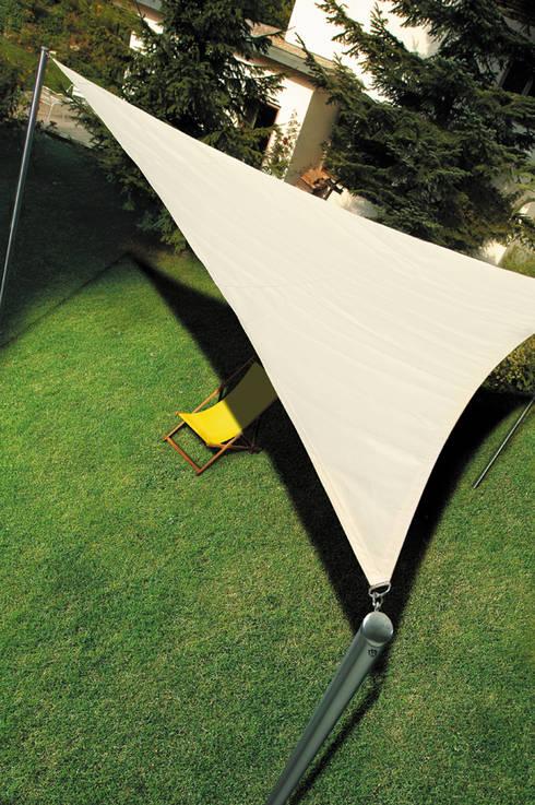 Jardín de estilo  por DISTRIBUCIONES/JP