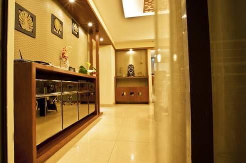 APARTMENT—ELITA PROMENADE:   by Creative Axis Interiors Pvt. Ltd.
