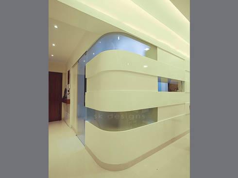 s k designs - contemporary residence in Andheri:  Corridor & hallway by S K Designs
