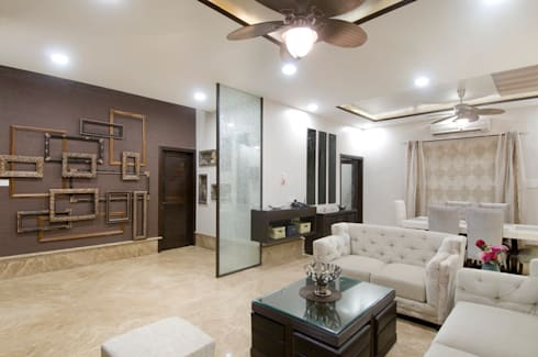 living room:  Living room by artha interiors private limited