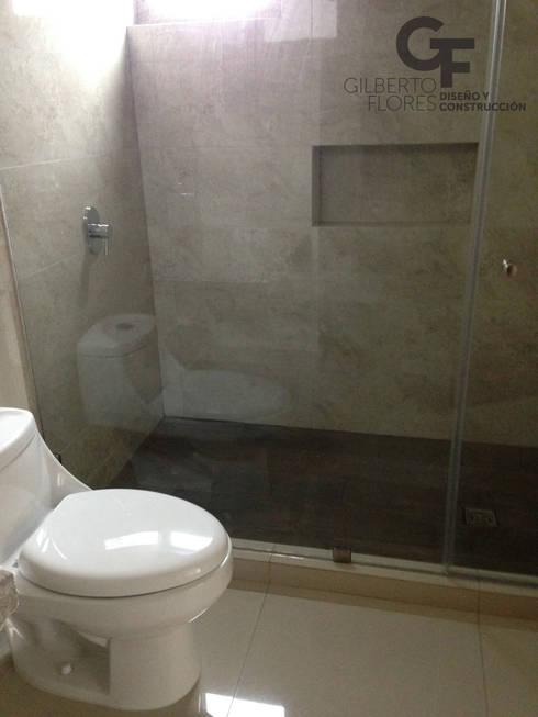 CAROLCO 1: Baños de estilo  por GF ARQUITECTOS