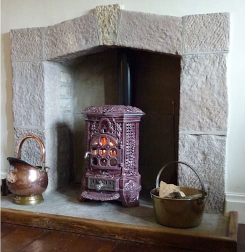 Beautiful Lancashire fireplace and French wood burner:  Living room by Stove Hunters
