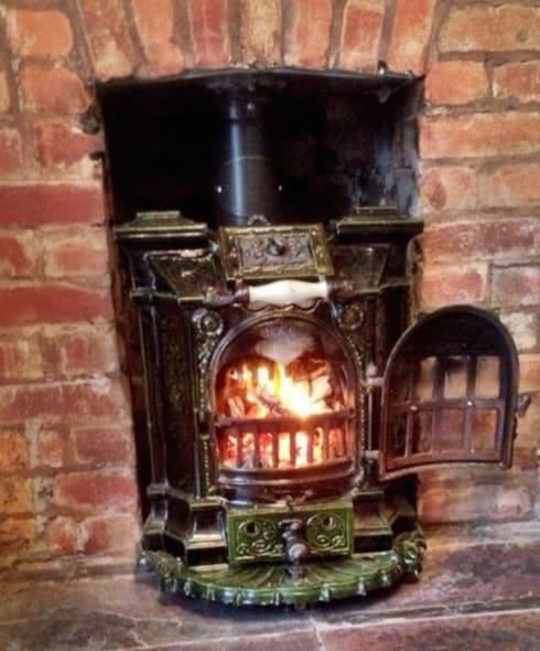 French Salamandre  stove:  Living room by Stove Hunters