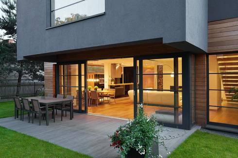 IQube House_: styl nowoczesne, w kategorii Domy zaprojektowany przez ARCHiPUNKTURA .architekci detalu