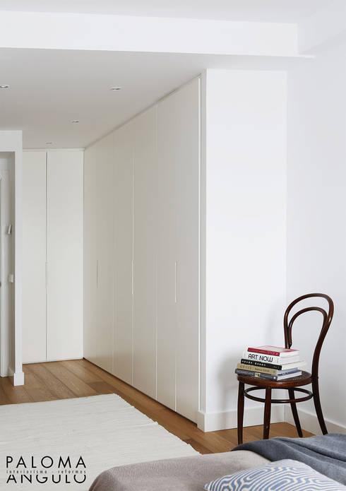 Vestidor: Vestidores de estilo  de Interiorismo Paloma Angulo