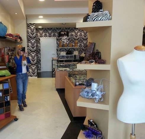 Interior del establecimiento: Espacios comerciales de estilo  de Arquitectos Fin