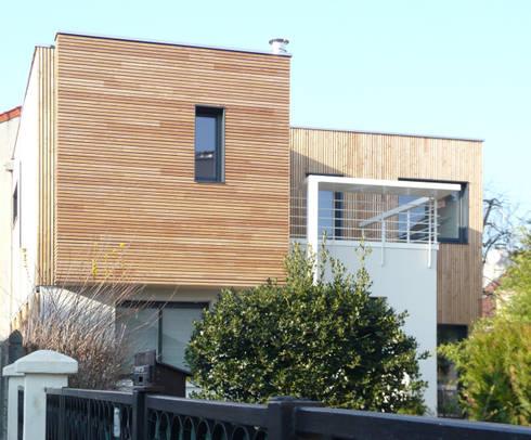 Maison de ville sur l vation et extension en bois pr s for Extension maison 93