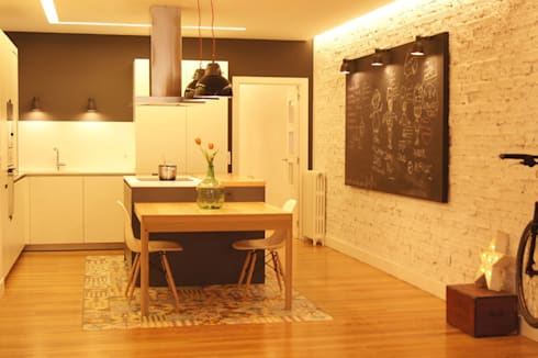 Sube Susaeta Interiorismo diseña y decora cocina abierta: Cocinas de estilo industrial de Sube Susaeta Interiorismo