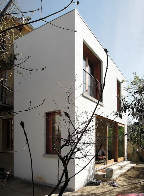 Réhabilitation et extension d'une maison de ville à Lyon: Maisons de style de style Moderne par Gerald Lafond architecte
