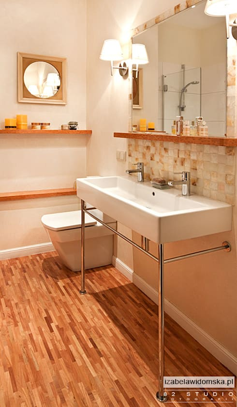 Baños de estilo  por Izabela Widomska Interiors