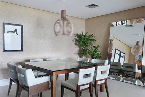 Apartamento Cond. Golden Green: Salas de jantar modernas por Cadore Arquitetura