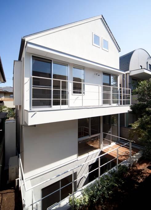 猫と暮らす家: Unico design一級建築士事務所が手掛けた家です。
