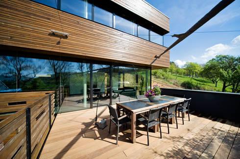 kologisches massivholzhaus von massive passive homify. Black Bedroom Furniture Sets. Home Design Ideas